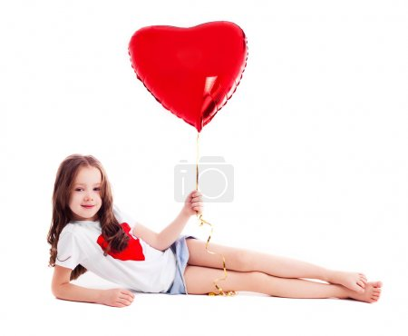 Photo for Cute six year old girl with a big red heart-shaped balloon, isolated against white background - Royalty Free Image