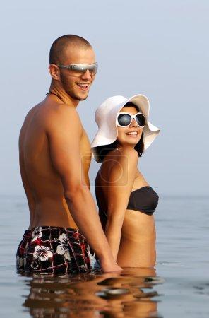 Happy couple in sea