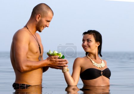Closeup portrait of a happy young couple in sea