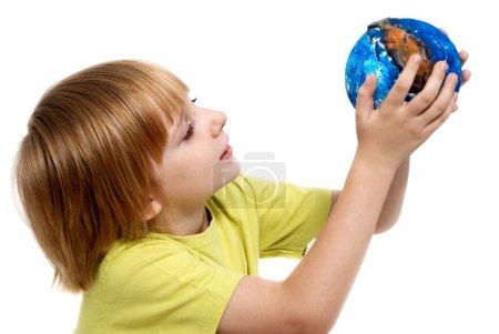 The little boy holding globe