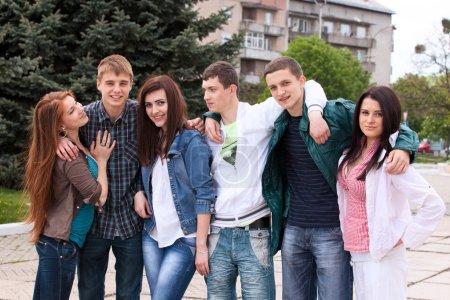 Teenage group embracing