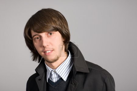 Photo for Smiling young man with a gray background. - Royalty Free Image
