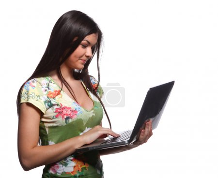 Beautiful college girl holding laptop and looking for an information