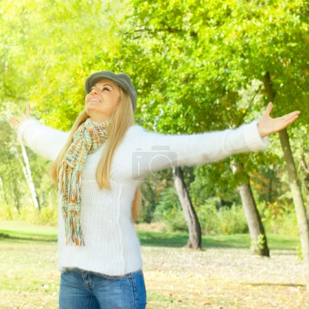 Photo for Happiness woman with raised hands enjoying in the nature. - Royalty Free Image