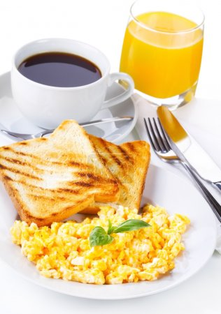 Photo for Breakfast with scrambled eggs, toasts, juice and coffee - Royalty Free Image