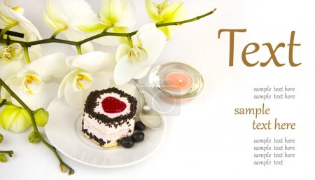 Photo for Cake on the background of a beautiful orchid (With sample text) - Royalty Free Image