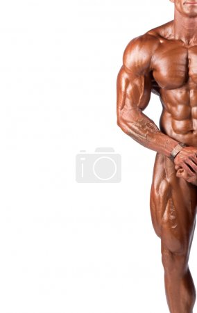 Photo for Bodybuilder flexing his muscles in studio - Royalty Free Image