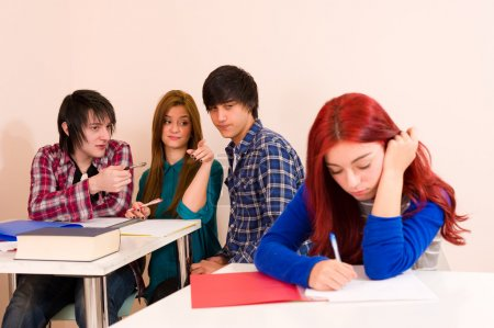 Photo for Female student excluded from the group - Royalty Free Image
