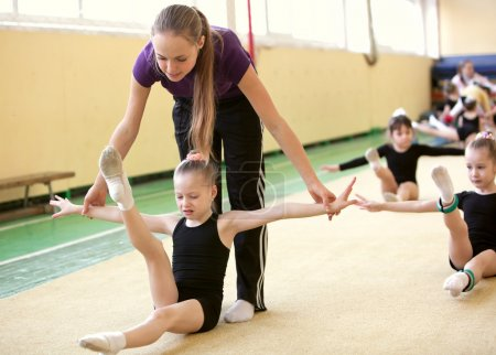 Young gymnast with coach