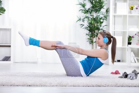 Photo for Young girl doing exercise for abdominals - Royalty Free Image