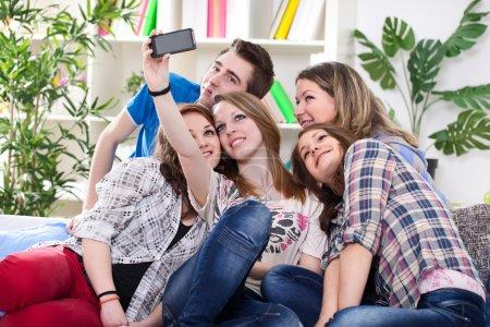 Teenagers taking group photo