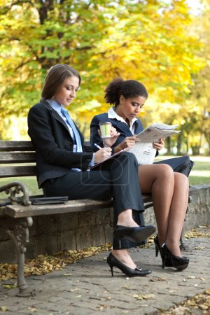 Photo for Two young businesswomen on break in park - Royalty Free Image