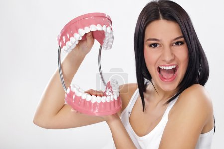 Funny young woman with jaws