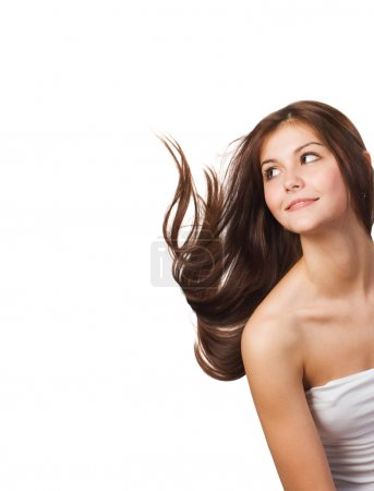 Photo for Pretty young woman with streaming hair isolated on white background - Royalty Free Image