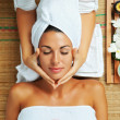 Portrait of young beautiful woman in spa environme...