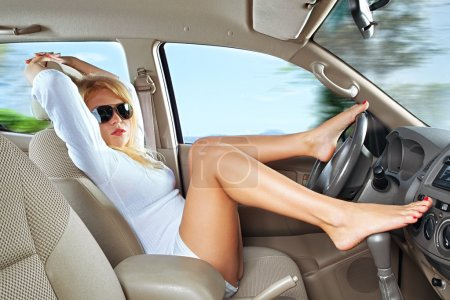 Photo for Portrait of young beautiful woman sitting in the car - Royalty Free Image