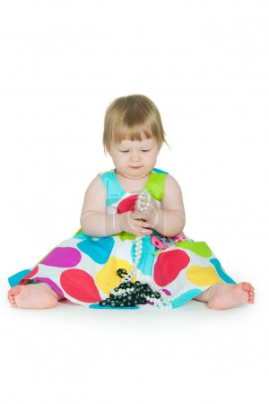 Photo for The image of the little girl with a beads in hands - Royalty Free Image