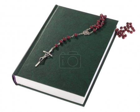 Photo for Rosary on the Bible, isolated on white - Royalty Free Image
