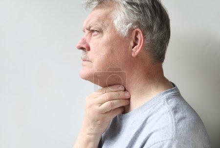 Man with throat pain