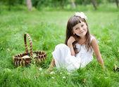 Beautiful girl outside in a garden