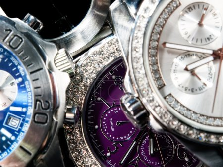 Macro view of many wrist watches....