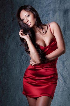 Brunette in red evening dress