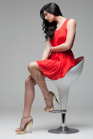 Gorgeous brunette on chair