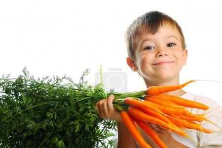 Photo for Boy eating fresh carrots isolated on white background - Royalty Free Image