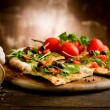 Photo of delicious vegetarian pizza with arugula o...