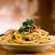 Delicious vegetarian dish of pasta with olives and...