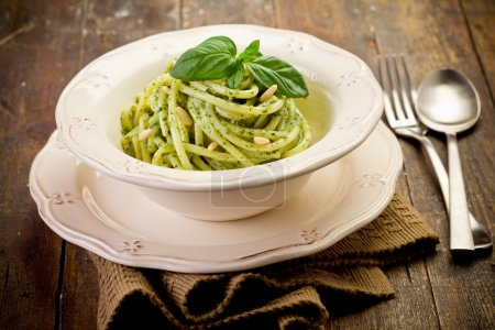 Photo for Delicious italian pasta with ligurian pesto and pine nuts - Royalty Free Image