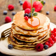 Delicious pancakes on wooden table with fruits...