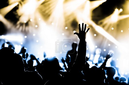 Photo for Crowd cheering with hands raised at a live music concert - Royalty Free Image