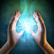 Two hands creating an energy sphere. Digital illus...
