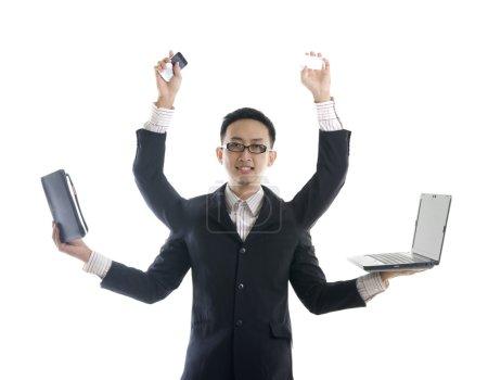 Asian male multitasking