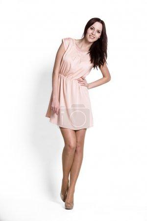 Photo pour Fille glamour en robe sur blanc - image libre de droit