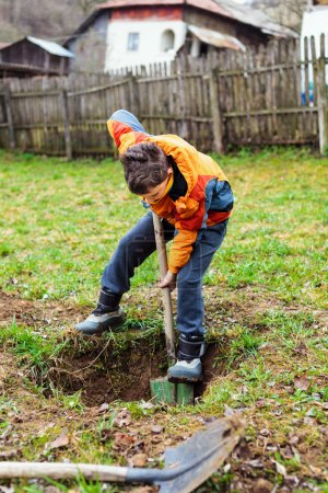 Boy digging in the ground