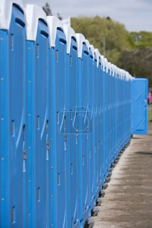Photo for Row of Blue Portable Toilets - Royalty Free Image