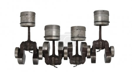 Four old piston and connecting rod on white backgr...