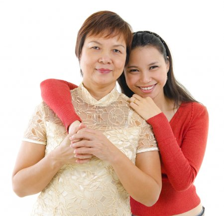 Photo for Mixed race daughter hugging her mother isolated on white background - Royalty Free Image