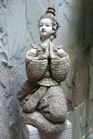 Photo for Asian statue in the form of a girl praying - Royalty Free Image