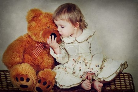 Photo for Little girl hugging teddy bear - Royalty Free Image