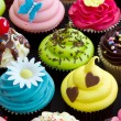 Assortment of brightly decorated cupcakes...