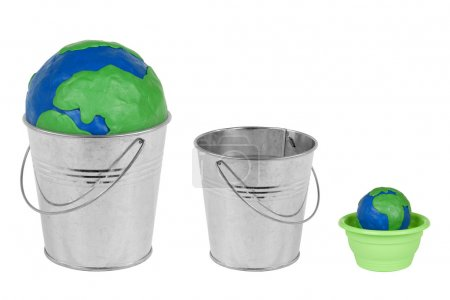 Two metal buckets, flower pot and the Globe