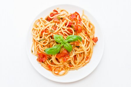 Photo for Decorated pasta with tomato and basil - Royalty Free Image