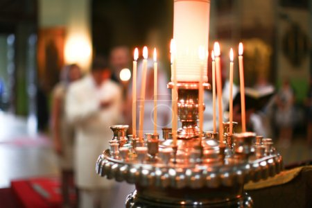 Photo for Wedding accessories and interior in Saint Trinity Orthodox Convent including candlesticks with many candles and in a background. Wonderful church in Riga, Latvia - Royalty Free Image