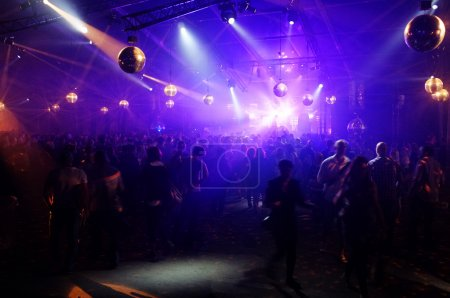 Photo for DJ entertaining a crowd in a party tent. - Royalty Free Image