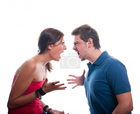 Studio shot of a young couple fighting