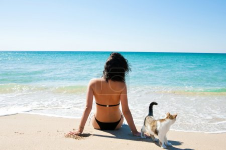 Girl on the beach with a kitten