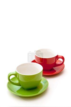 Photo pour Tasses à café verts et rouges, gros plan l'image - image libre de droit